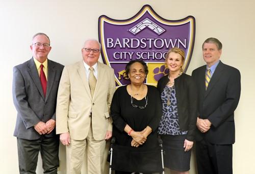Board Members in front of Bardstown City Schools logo