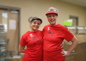 Two food service employees with Dr. Seuss shirts