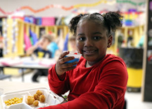 Student enjoying lunch in the classroom