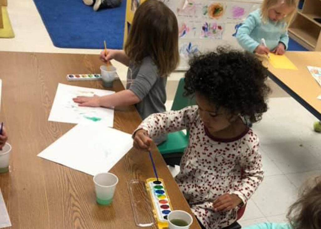 Childcare students painting